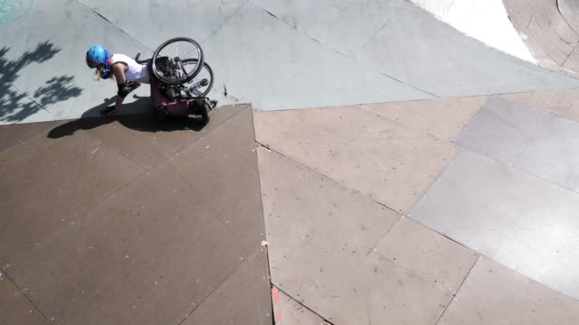woman in wheelchair in skate park - standing up after falling down - stunt stock videos & royalty-free footage