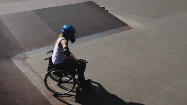 woman in wheelchair in skate park - wheelchair stock videos and b-roll footage