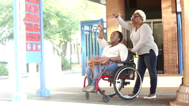 woman in wheelchair with senior mother at train station - full length stock videos & royalty-free footage