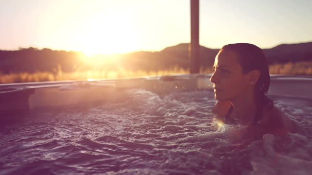 Woman in whirlpool hot tub