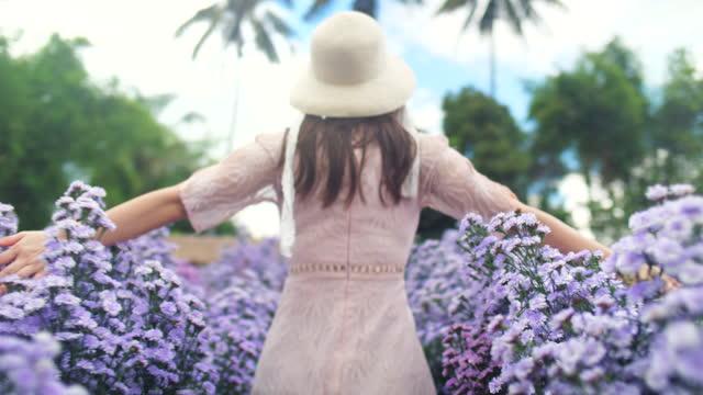 woman in white dress walking in flower field - white dress stock videos & royalty-free footage