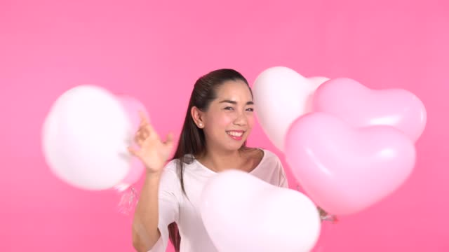 woman in white dress with balloon - white dress stock videos & royalty-free footage