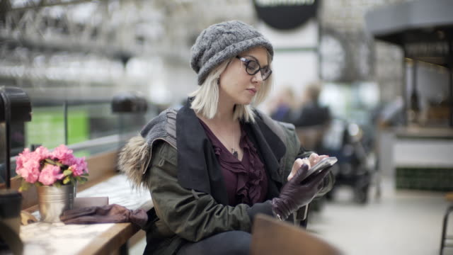 A woman in winter styling in a cafe