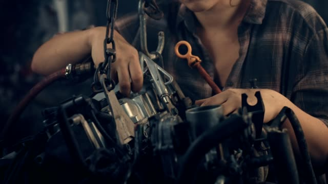 woman in workshop garage. fixing engine. close up on hands - hobbies stock videos & royalty-free footage