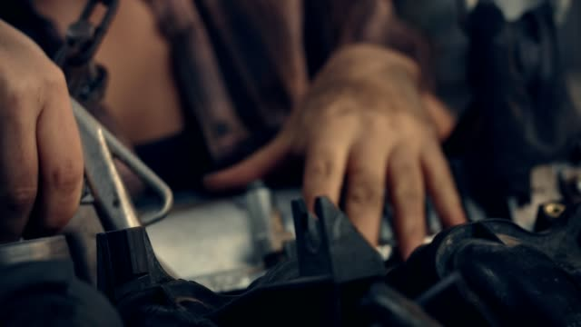 woman in workshop garage. fixing engine. close up on hands - manual worker stock videos & royalty-free footage