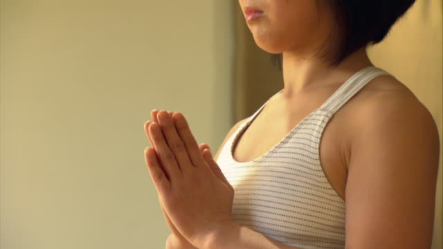 cu tu woman in yoga studio stretching and bending over/ new york, ny - bending over stock videos & royalty-free footage