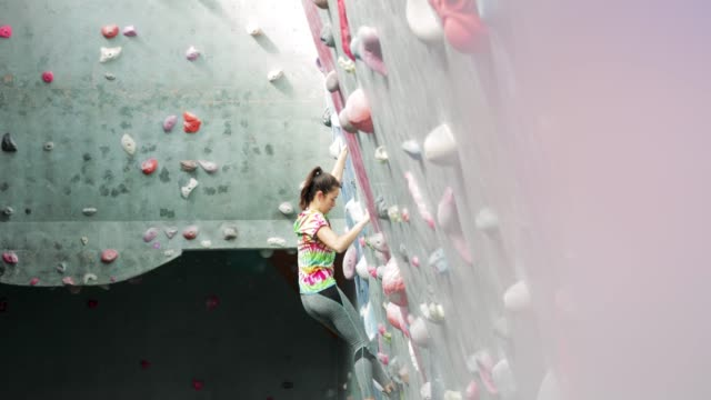 woman indoor climbing - climbing stock videos & royalty-free footage