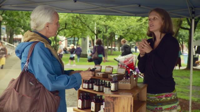 ms woman inquires about bottle to woman / burlington, vermont, usa  - burlington vermont stock videos & royalty-free footage