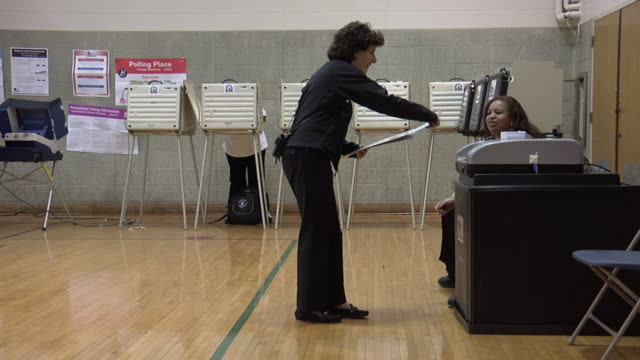 ms, woman inserting voting ballot into ballot box, chicago, illinois, usa - ballot box stock videos & royalty-free footage