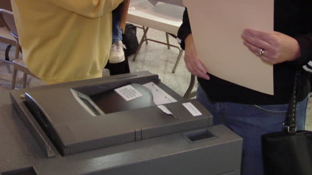cu, woman inserting voting ballot into ballot box, st. marys, ohio, usa - voting ballot stock videos and b-roll footage