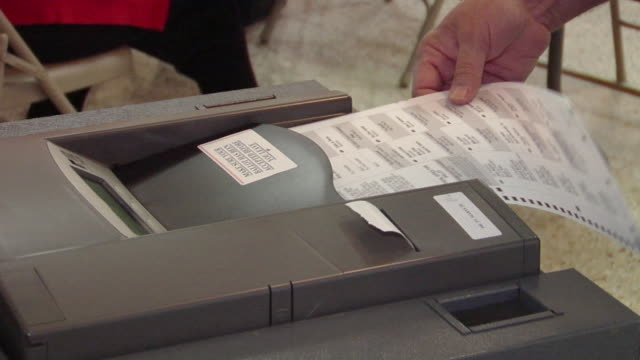 ecu, woman inserting voting ballot into ballot box, st. marys, ohio, usa - 投票点の映像素材/bロール