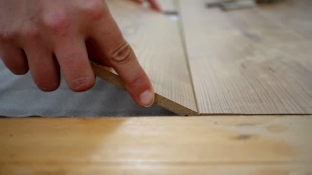 woman installing laminate flooring. - hardwood floor stock videos & royalty-free footage