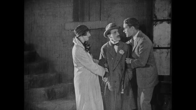 stockvideo's en b-roll-footage met 1925 woman introduces her boyfriend to man who leaves with his girlfriend - 1925
