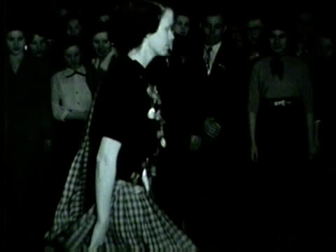 a woman irish dancing in front of a crowd plus another woman being crowned in chicago in 1953 - traditional ceremony stock videos & royalty-free footage