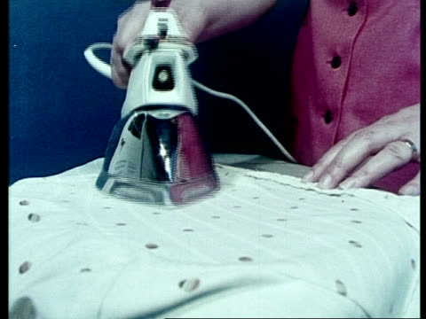 stockvideo's en b-roll-footage met woman ironing, archive - strijkijzer