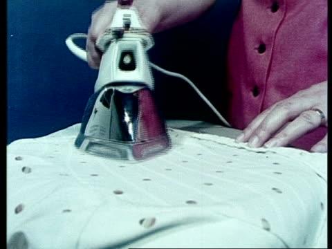 vídeos y material grabado en eventos de stock de woman ironing, archive - plancha