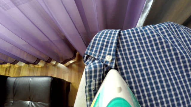 woman ironing clothes, point of view - iron appliance stock videos & royalty-free footage