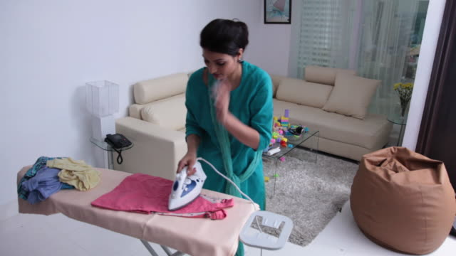woman ironing clothes  - ironing board stock videos & royalty-free footage