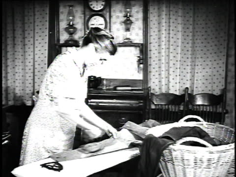 1923 ms woman ironing shirt / united states - 1923 stock videos & royalty-free footage