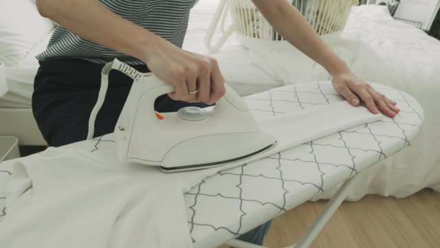 woman ironing - stock video - ironing board stock videos & royalty-free footage