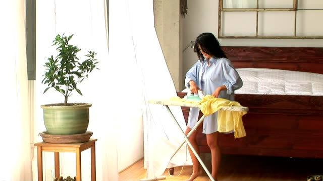 woman ironing - 10 seconds or greater stock videos & royalty-free footage