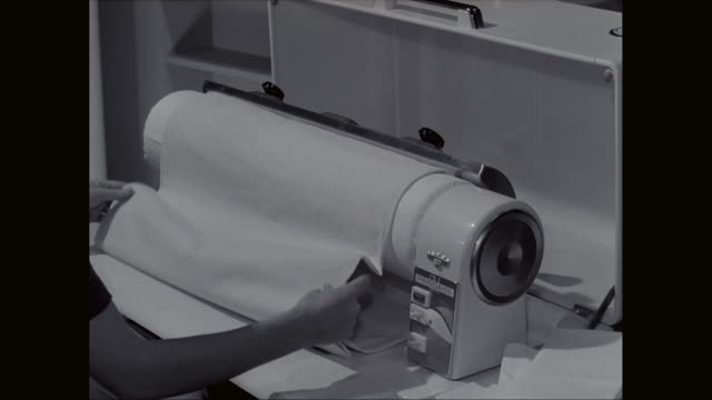 ms woman ironing white sheets at home / united states - rolling stock videos & royalty-free footage