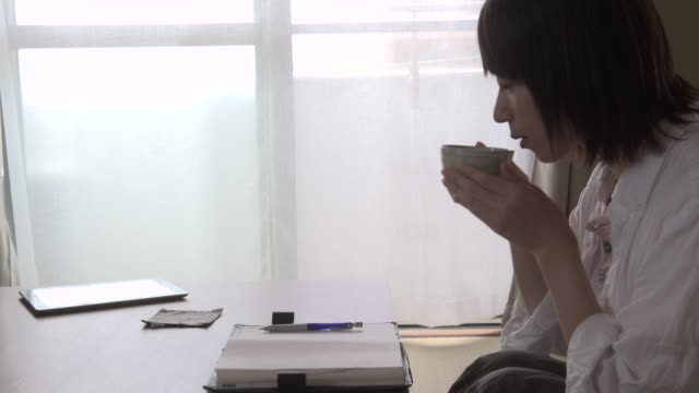 Woman is a note to schedule book in the room / Kyoto,Japan