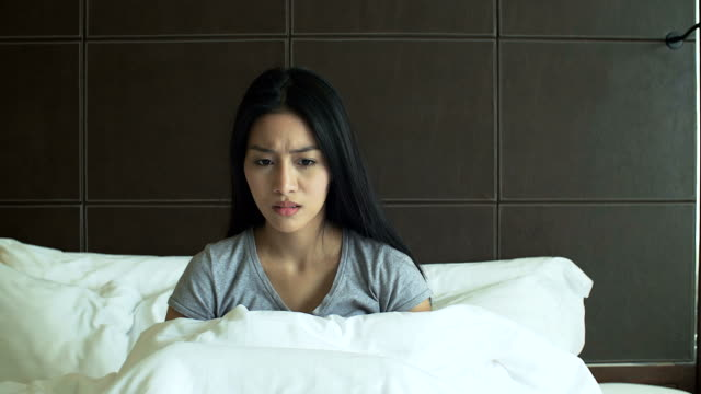 4K: Woman is awaken from nightmare with anxiety feeling