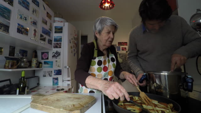 woman is cooking with her son - 45 49 years stock videos & royalty-free footage