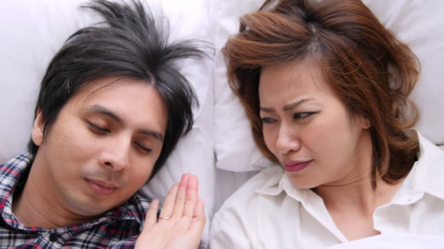 4k : woman is disturbed by man is snoring - snoring stock videos and b-roll footage