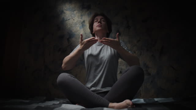 woman is doing breathing exercise at home - breathing exercise stock videos & royalty-free footage