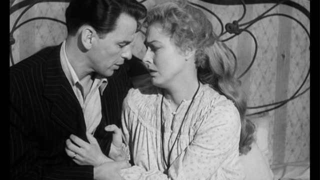 1955 woman (eleanor parker) is emotional over husband's (frank sinatra) leaving - pleading stock videos & royalty-free footage