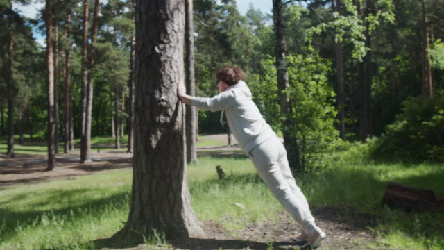woman is exercising in forest - one mature woman only stock videos & royalty-free footage