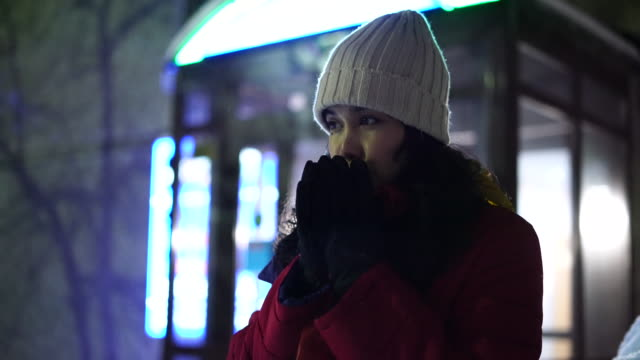 woman is feeling cold in downtown - shivering stock videos & royalty-free footage