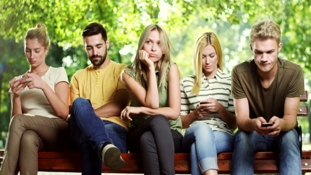 woman is getting bored while all his friends looking at phone - dependency stock videos & royalty-free footage