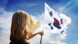Woman is Holding Flag Pole with South Korean Flag in 4K Resolution
