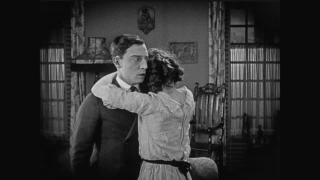 1920 Woman is jealous of photograph in man's (Buster Keaton) room