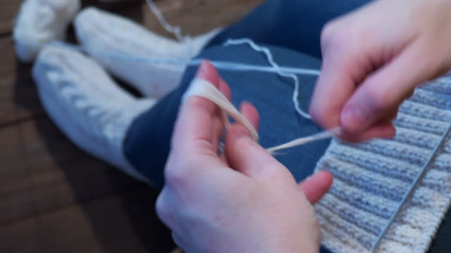 woman is knitting - ball of wool stock videos & royalty-free footage