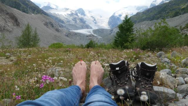 woman is looking at glacier morteratsch in switzerland - besonderes lebensereignis stock-videos und b-roll-filmmaterial