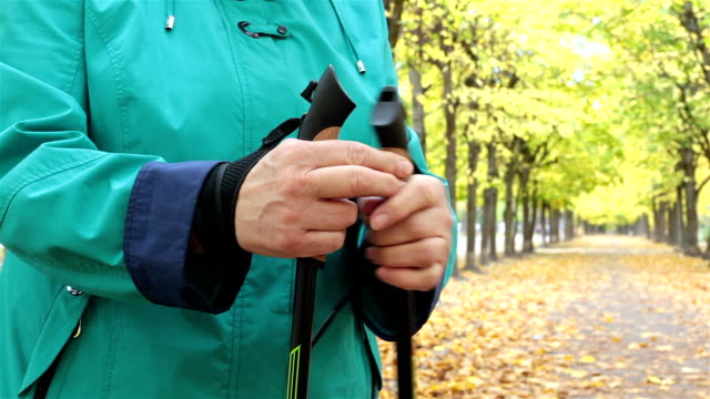 a woman is preparing for nordic walking. - ukrainian ethnicity stock videos and b-roll footage