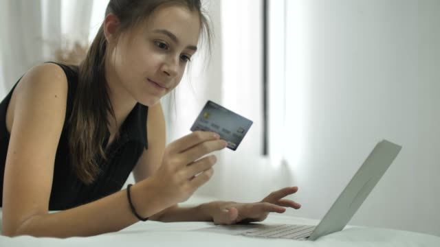 woman is shopping online using laptop - online shopping stock videos & royalty-free footage