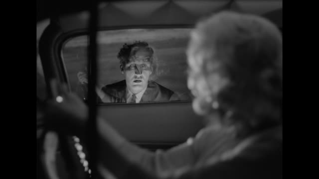1962 a woman is startled by a ghostly appearance - accelerator pedal stock videos & royalty-free footage