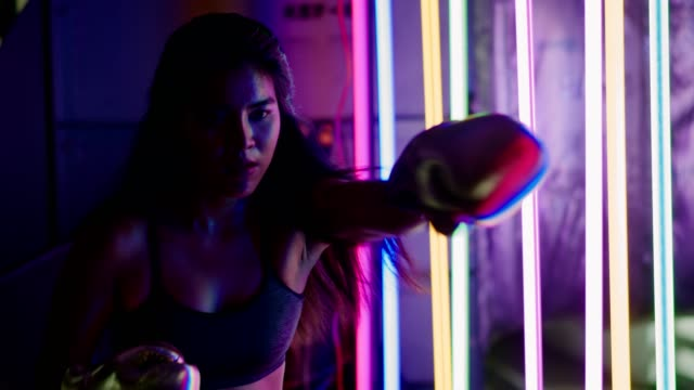 woman is training, punching with silver gold mitts gloves - glove fist stock videos & royalty-free footage