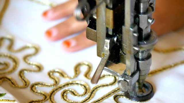 woman is working in embroidery machine - thread sewing item stock videos & royalty-free footage
