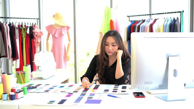 woman is working in her tailor shop. - tailored clothing stock videos & royalty-free footage