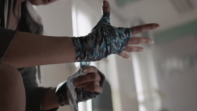 woman is wrapping hands with boxing wraps - wrapping paper stock videos & royalty-free footage