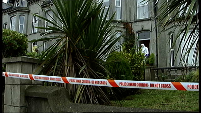 Woman jailed for beating pensioner to death with crucifix December 2008 EXT Forensic officers outside home of Maire Rankin Flowers at scene Close...