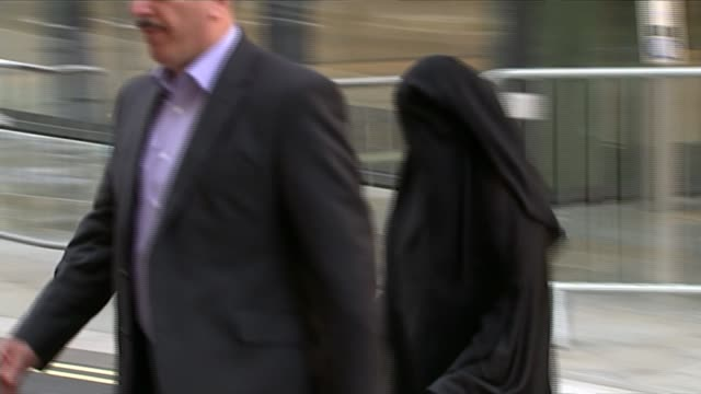 woman jailed for encouraging terrorism on twitter; england: london: old bailey: ext alaa esayed arriving at court wearing burka - 僧衣点の映像素材/bロール