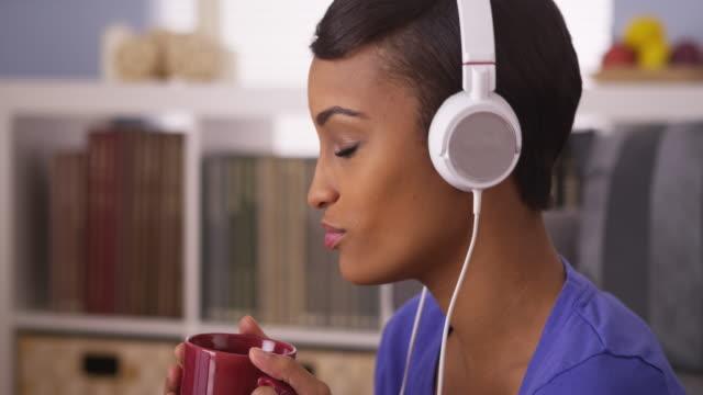 woman jamming to music with mug
