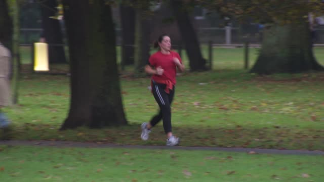 woman jogging in a park, uk - only mature women stock videos & royalty-free footage